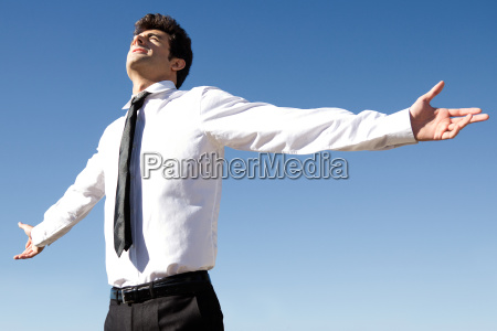 happy successful business man raised arms