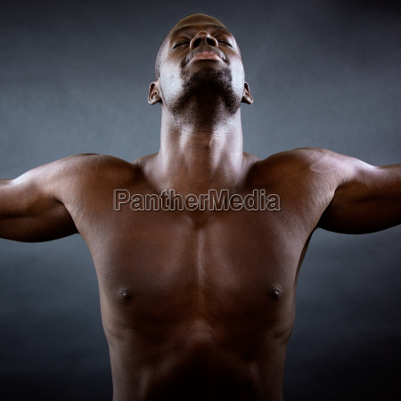 muscular man with his arms outstretched