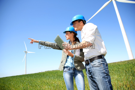 engineers looking at wind turbine site
