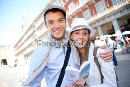 couple standing in la plaza mayor