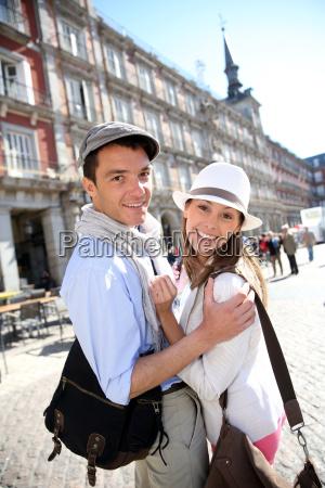 couple of tourists visiting la plaza