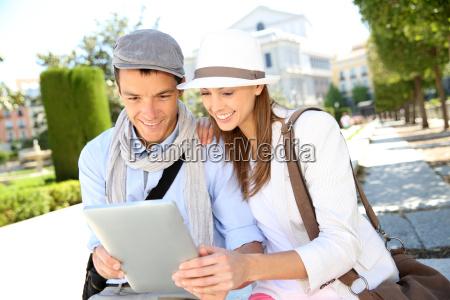 tourists in plaza de oriente looking