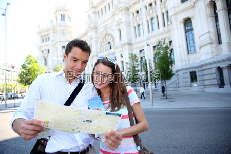 tourists reading map in front of
