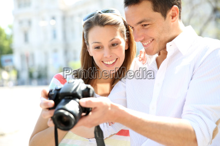 happy couple looking at pictures on