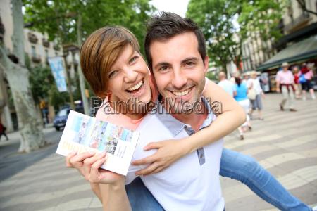 cheerful couple in la rambla of