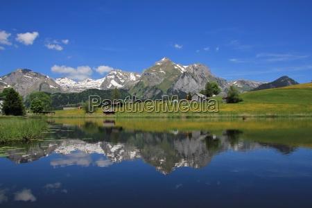 alpstein range mirroring in lake schwendisee