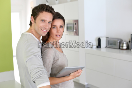 cheerful couple looking at internet on
