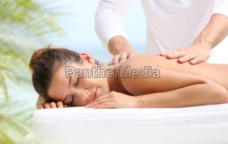 brunette girl receiving a massage