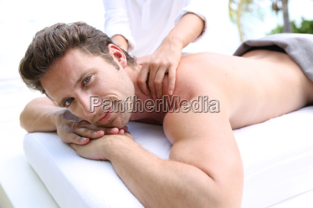 handsome man laying on a massage