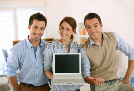 successful startup people showing laptop screen