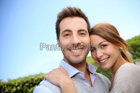 cheerful young couple embracing each other