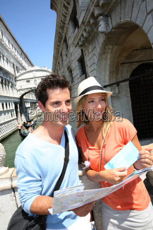 couple looking at map by the