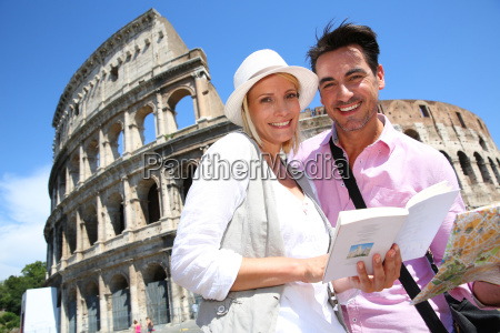 couple in rome reading guide book
