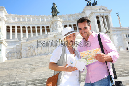 couple reading map by the monument