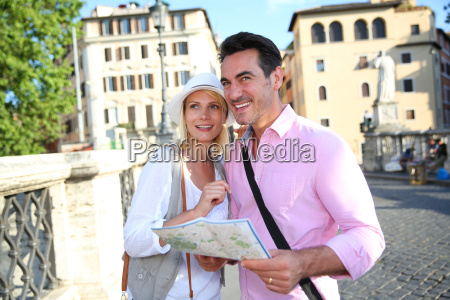 tourists in rome reading map on