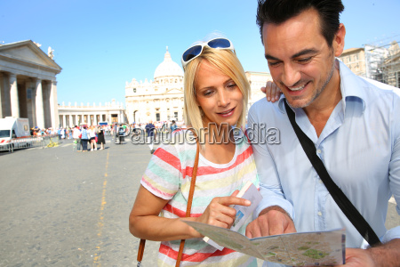 tourits with map in front of