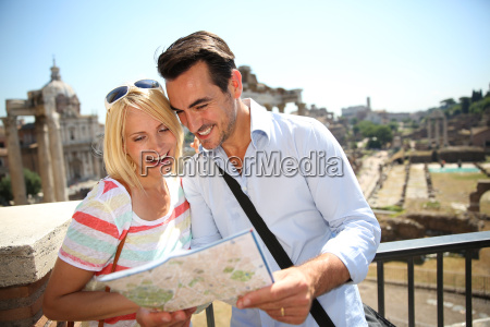 couple, of, tourists, reading, city, map - 17803254