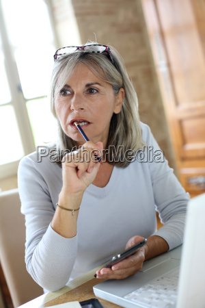 senior woman at home figuring out