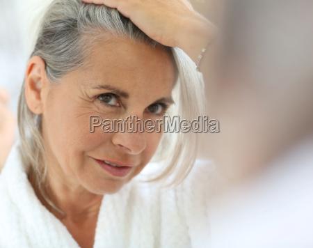 senior woman worried by hair getting