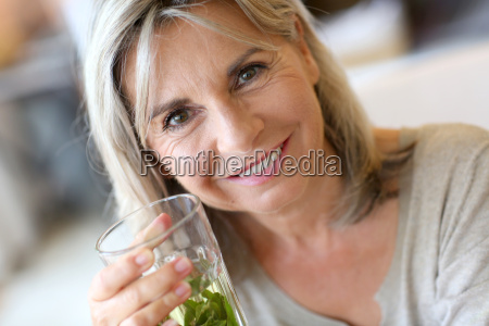 senior woman drinking verbena tea