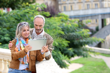 senior tourists looking for information on