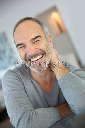 portrait of happy handsome mature man