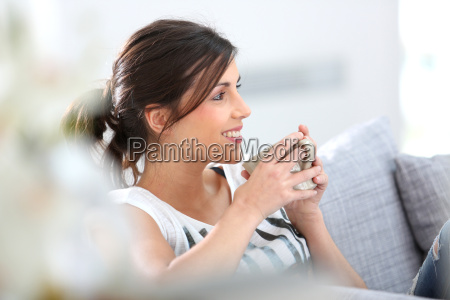 young woman relaxing in sofa with