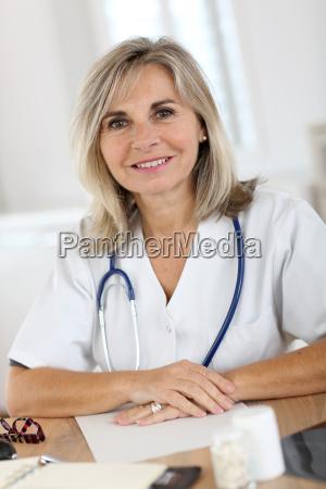 portrait of smiling senior nurse in