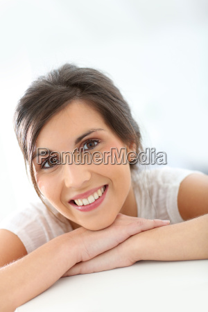 portrait of smiling young woman isolated