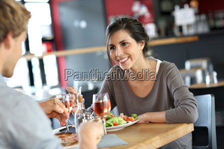 young woman in restaurant eating lunch
