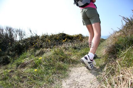 closeup of backpacking womens legs