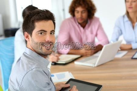 smiling businessman attending business meeting
