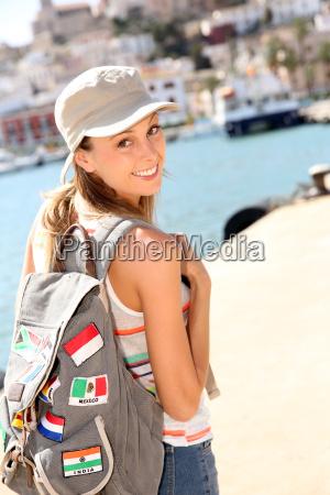 cheerful girl visiting ibiza island