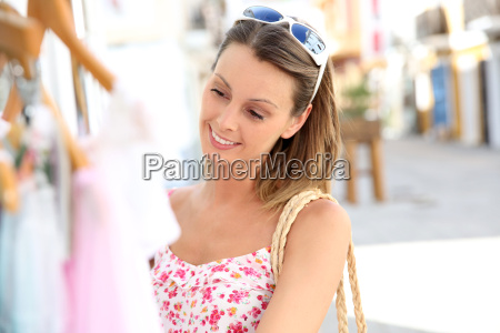 attractive young woman doing shopping in