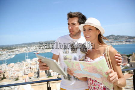 couple of tourists reading map at