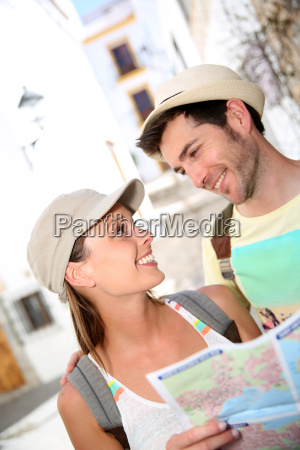 happy couple visiting typical mediterranean village