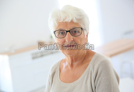 portrait of elderly woman with eyeglasses