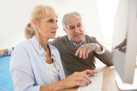 senior people in office working on