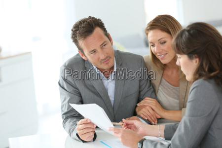 clients and banker meeting for mortgage
