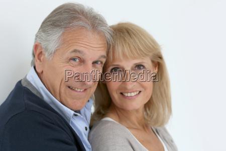 portrait of senior couple embracing each