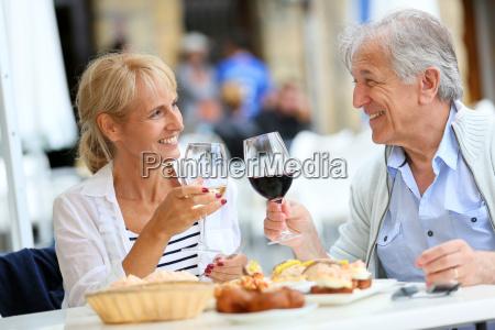 senior couple eating spanish fingerfood in
