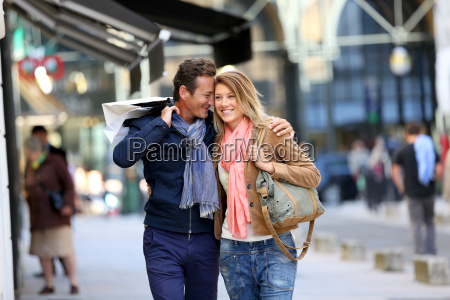 middle aged couple doing shopping on