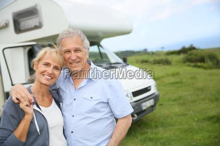happy senior couple standing in front