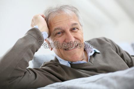 portrait of smiling senior man sitting