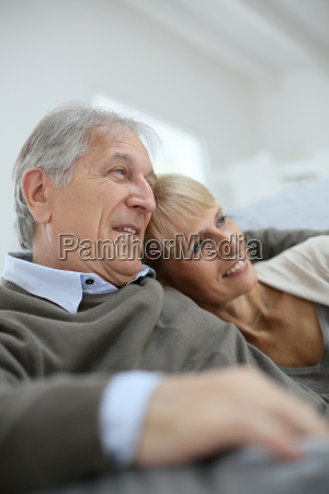 senior couple relaxing in sofa and