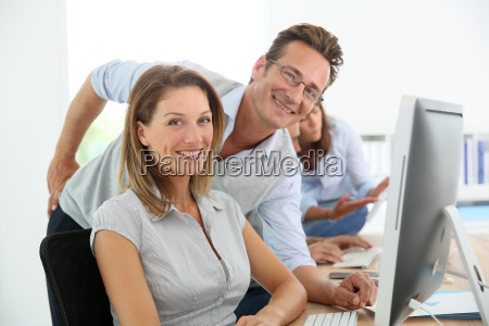 middle aged business people working on