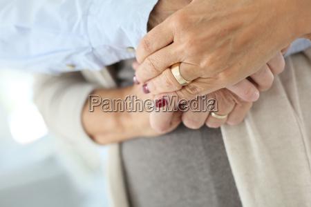 closeup of senior peoples hands held