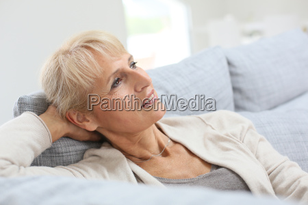senior woman relaxing in sofa and