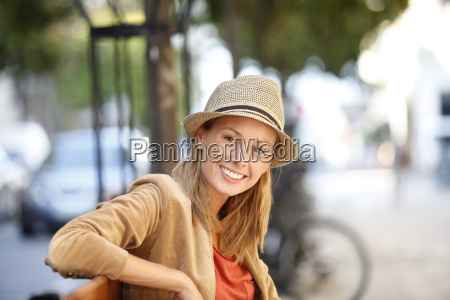 portrait of smiling woman sitting on