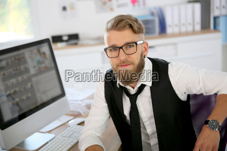 young man with beard and eyeglasses